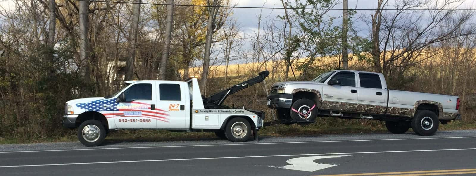 Truck being towed