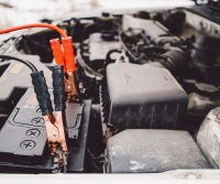jumper cables clamped onto a battery